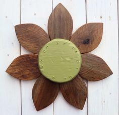 Barn wood petals add organic dimension to a bright flower center for our barn wood wall art flower.    Measures 18 x 18. READY TO HANG, indoors or