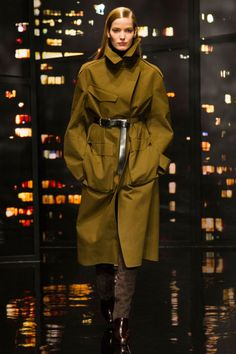 She worked in a masculine/military motif with utility anoraks in white and olive drab belted over satin skirts and skinny pants. The coats in general were pretty terrific, from spare men's-inspired toppers to finely-embellished black cashmere car coats to belted blazers.