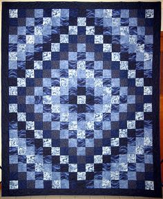 Trip Around the World, I love blue quilts.I realize it would take forever, but it's absolutely mesmerizing.