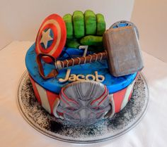 Jacob's Avengers, Age of Ultron cake! 12 inch round cake, all buttercream and candy clay details, with candy clay Ultron, Captain America's shield, Iron Man's chest piece, Hulk's fist and Thor's hammer! Hulk's fist and Thor's hammer made with rice krispy treats and candy clay! All edible and no fondant!  https://www.facebook.com/angelas.cakes2011