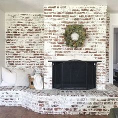 "Good evening friends! Here is the finish look of the Faux ""German Smear"" brick fireplace! I seriously can't get over on how AMAZING it turned out! Thanks to my boo Jessica @the_rusticpallet for helping me (aka taking over) and all the other projects! I couldn't have done this with out you."