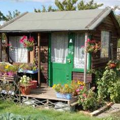 I so need a shed like this one! Allotment sheds come in all shapes & sizes Allotment Shed, Greenhouse Shed, Allotment Ideas, Pool Houses, Glass Houses, Potting Sheds, Potting Benches, Shed Playhouse, Shed Of The Year