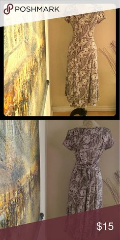 **PAISLEY DESIGN DRESS 99%Polyester.  The tie on the waist can be worn forward or backward.  It's flattering and comfortable to wear.  Excellant condition. Perceptions Dresses Maxi