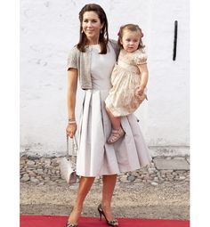 Crown Princess Mary of Denmark and Princess Isabella are shown attending the christening of her nephew, Prince Joachim and Princess Marie's new son, Prince Henrik Carl Joachim Alain, at Denmark's Mogeltonder Church on 26 July 2008.