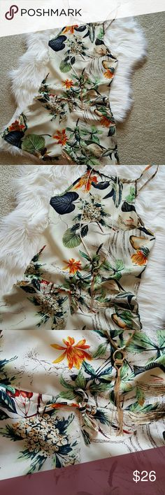 """🌻 TROPICAL ROMPER🌻FREE GIFT WITH PURCHASE 🌻 🌻Beautiful TROPICAL romper. It is a xl but fits like a large, very cute. Length is 36"""" from strap, bust across is 19"""". Waist across lying flat 19"""", and hips 21"""", very bottom of romper 25"""" across. Leg holes are 14"""" lying flat so double that around. BUNDLE AND SAVE 20%🌻.FREE GIFT WITH PURCHASE🌻 Accessories not included.🌻 NWOT! Shorts"""