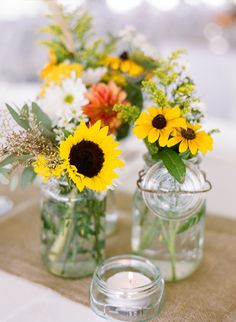 rustic fall wedding wildflower centerpieces in mason jars with burlap. sunflowers