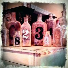 My old number bottles, cheapest creation ever. A must for me is that the bottles be old and dirty full of character!~Junk Market Style