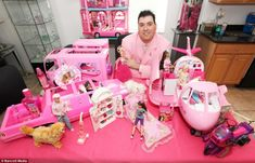 The collection doesn't stop at the dolls - Barbie-branded mouthwash, toothbrush, plasters and many of Barbie's vehicles are on display at th...