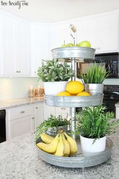 tiered stand for fresh produce helps to declutter kitchen counters