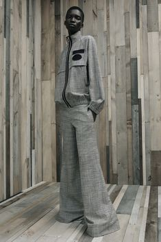 """Alexander Wang Resort 2016 - Look 7 - the delightful thing about being a fashion consumer is that the only valuation I must make of fashion is, """"do I like it?"""" And it really doesn't matter what anyone else thinks. Love this gray crosshatched star trek/auto shop/70's track suit with black accents"""