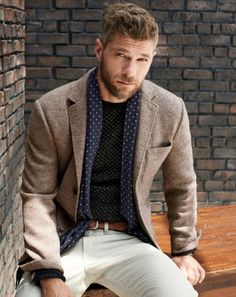 Pair a brown wool blazer jacket with white chinos to look classy but not particularly formal.  Shop this look for $147:  http://lookastic.com/men/looks/crew-neck-sweater-scarf-belt-blazer-chinos/6490  — Black Crew-neck Sweater  — Navy and White Polka Dot Silk Scarf  — Brown Leather Belt  — Brown Wool Blazer  — White Chinos