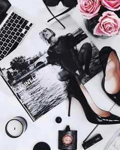 Beauty flat lay - Pigalle Louboutins, YSL Black Opium perfume, Celine sunglasses, DW Home candle, YSL lip stain -