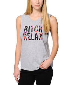 """Tell it like it is in the Married To The Mob Relax Tropic Grey muscle T-Shirt for girls. At the front of this cut-off T-Shirt from Married To The Mob there is """"Bitch Relax"""" lettering in a tropical sunset print for a bold look, while the boyfriend fit"""