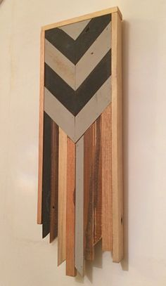 One from the collection of chevron wall hangings created in June 2016. Each piece is individual, but collectively they are made from reclaimed wood sourced from the local area to the workshop. Colours are achieved using a combination of natural wood and non-toxic wood dyes. Dimensions: Length: 36cm Width: 13.5cm Depth: 3cm See more of my wall hangings here: https://www.etsy.com/uk/shop/RobertsonCheney?ref=hdr_shop_menu&section_id=19400621 See my tabl...