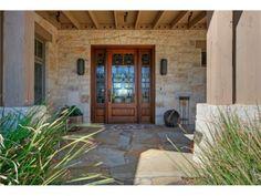 A unique wood/ mosaic glass front door. Austin, TX Coldwell Banker United, Realtors $2,899,000
