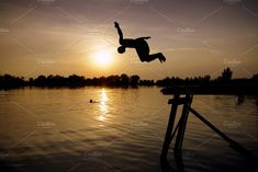 Boy jumps to the lake in sunset by OctopusRider on @creativemarket