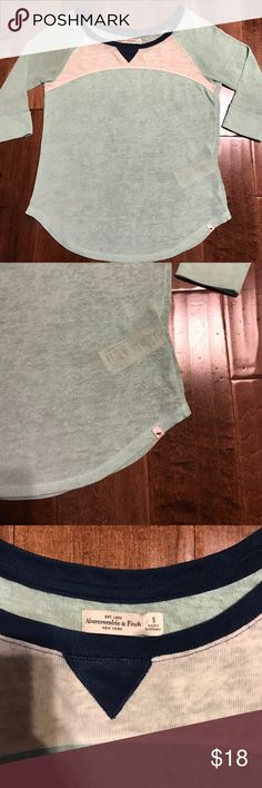 Abercrombie Raglan Spring Sweater Lightweight burnout type lightweight sweater material. 3/4 Sleeves. Great condition, has slight piling from normal wash and wear, not very noticeable, just disclosing. Mint color with navy and white scoop neckline. Abercrombie & Fitch Tops Tunics