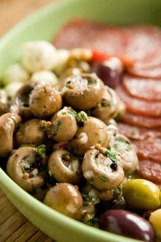 A reader sent us this recipe that she's been making for over 40 years. We replaced the dried herbs with fresh oregano and parsley and added some garlic and onion to boost the flavor even more. These mushrooms make a great addition to an antipasti platter with cubes of cheese, a pile of olives, slivers of roasted red peppers and paper-thin slices of prosciutto.