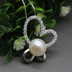 Cultured Pearl Sterling Silver Pendants, it inset a pearl on the sterling silver frame. Looks more beautiful.