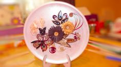 quilling on a decorative plate https://www.facebook.com/QuillingByCami