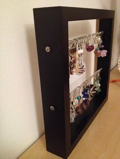 Materials: Ribba (ikea) picture frame    Description: Do you want to find easily all your earrings?