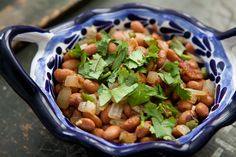 Pinto Beans with Bacon and Jalapeños Recipe with olive oil, chile pepper, bacon, chopped onion, garlic, pinto beans, salt, chopped cilantro fresh