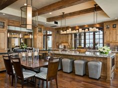Love the big open kitchen with exposed wood beams on the ceiling...and the countertops and cabinets.