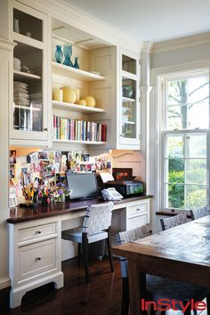 love the idea of a desk in the kitchen area. perhaps where the red cabinet is now...Jerry and Jessica Seinfeld's Hamptons House InStyle 4