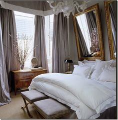 It might be a bit more feminine but I really like this romantic grey bedroom. The gold frames and white fluffy bedding make it look oh so inviting!