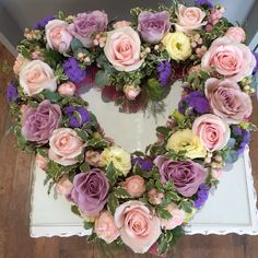 Loose heart funeral flowers heart in pinks and mauve