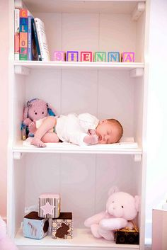 Infant picture on bookshelf
