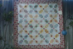 Love the block in block settings that look like X's - from American Quilting's 2011 Garden Party