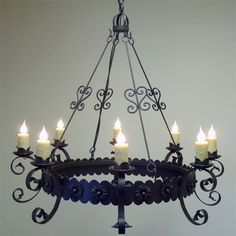 ILLUMINARIES Lighting offers a variety of wrought iron chandeliers, wrought iron pendants, wrought iron sconces and outdoor lighting. Wagon Wheel Chandelier Diy, Chandelier For Sale, Rustic Chandelier, Rustic Lighting, Outdoor Lighting, Wrought Iron Light Fixtures, Wrought Iron Decor, Wrought Iron Chandeliers, Rustic Light Fixtures