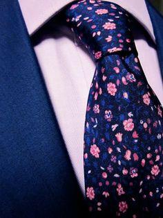 Mark Pomerantz 5-fold floral silk tie, lavender shirt and blue suit.