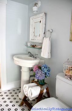 Vintage bathroom - love the floor and color (and that cute ladder)!  eclecticallyvintage.com