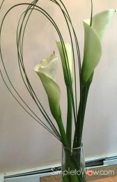 trio of floral arrangements-cala lily with steel grass