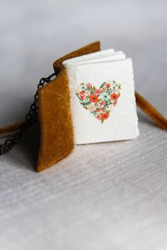 Hand made and customized miniature book necklace. Order what you see or design your own for no extra cost! Book Size: 1 inch X inches Book Necklace, Design Your Own, Ribbon, Miniatures, Necklaces, Trending Outfits, Unique Jewelry, Handmade Gifts, Leather