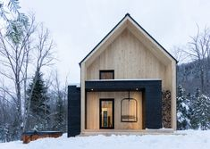Designed by Cargo Architecture, the Villa Boréale is a charming contemporary residence located in Charlevoix, an eastern region of the Quebec Province well known for its wooded valleys, skiable mountains and breathtaking points of view.   At the heart of the boreal forest, the Villa is set on a sloped and private site, matching up nicely with the ubiquitous vegetation of the surroundings.  More architecture inspiration via Uncrate