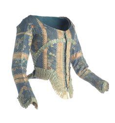 Jubón   Majismo, ca. 1782-1795  Jubón listado en seda azul y beige con alternancia de tafetán y raso decorado con bastas flotantes de tema floral, a modo de cintas serpenteantes. Va ajustado al torso, con escote redondo en el delantero y una pequeña cola en el borde inferior de la espalda.  MT009247