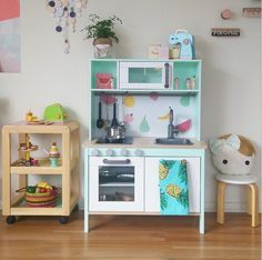 """10 Ways to """"Remodel"""" IKEA's DUKTIG Play Kitchen. Squee! I might give the kiddos' kitchen a remodel."""
