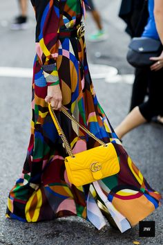 Woman wearing a Gucci belt and bag during New York Fashion Week Spring SUmmer 2017