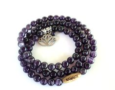 This listing if for one Lotus wrap bracelet. It features beautiful 6mm Amethyst gemstone beads a silver plated Lotus charm, a 6mm Amethyst bead, and a NAMASTE wood bead on a stretch cord. This can also be used as a necklace. Made to fit a 6'' inch wrist comfortably and will wrap 3x. **Please allow a small variation in bead color and beading patterns from that of picture. No two are alike.**