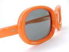 I love these...will I buy?  Vintage Orange 60s Sunglasses 1960s Italy. $64.00, via Etsy.