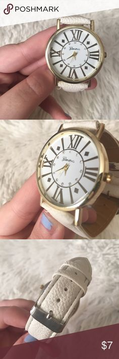 💙 white watch 💙 Never used, but it's a couple years old & needs a new battery as I guess it's been running this whole time. 😕 Super good condition with only a tiny scratch that's not even noticeable when wearing! Beautiful white and gold colored watch! White wristband with a gold accented face & clock. 😊 There's also these cute tiny gems on the clock! ✨ Even if you don't want to purchase a new battery- it's adorable worn just for fashion. Geneva Accessories Watches