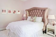 Chic girl's room features pink velvet tufted headboard on queen bed dressed in white ruched bedding and white pleated bedskirt flanked by stacked glass lamps on contemporary nightstands.