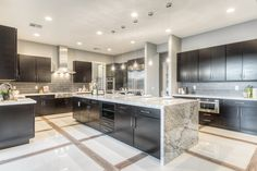 Modern Kitchen with Complex marble counters, Flush, EliteTile Sierra Polished Glass Grand Subway Tile in Ice White, U-shaped Luxury Kitchen Design, Kitchen Room Design, Luxury Kitchens, Home Decor Kitchen, Kitchen Designs, Kitchen Modern, Modern Kitchens, Kitchen Layouts, Kitchen White