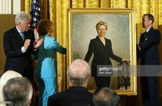 Former U.S. President Bill Clinton (L) and his wife U.S. Senator Hillary Clinton (D-NY) (2nd L) look at Hillary's portrait during a ceremony to unveil Clinton portraits in the East Room of the White House June 14, 2004 in Washington, DC. Every president since George Washington has had their portrait painted and displayed either at the White House or at the Library of Congress.