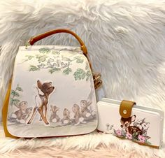 Brand new with tags Loungefly Disney Bambi portrait Mini Backpack and wallet set Comes with adjustable and removable straps can be used to convert the backpack into a crossbody bag! Backpack: 8 x x Wallet: 8 x x BoxLunch Exclusive Cute Mini Backpacks, Stylish Backpacks, Disney Furniture, Cute Disney Outfits, Bambi Disney, Disney Purse, Disney Souvenirs, Disney Inspired Fashion, Disneyland