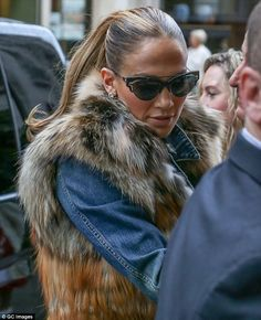 Quick change: Later J-Lo arrived at the luxurious Hotel Bristol in a denim jacket with fur...