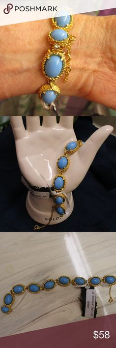 "De NICOLA Bracelet Rare Blue Cab Gold Vintage Lovely De NICOLA turquoise cabochon and gold design link bracelet. Cabochons are prong set and open back. Settings are gold tone metal with a delicate twisted rope and swag design.  8 links each measuring 3/4"" x 5/8"" x 5/16"" deep. Total length ~ 7 12"" x 5/8"".  Secure box latch with prong set faceted rhinestone on lever.  Gold safety chain for added security. A RARE find in such good condition as De NICOLA stopped producing in the 1970s.  EUC…"